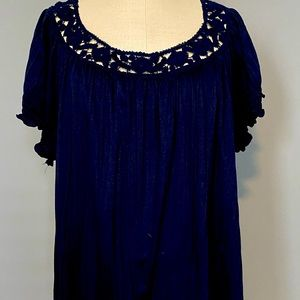 Woman's gently worn navy embroidered top